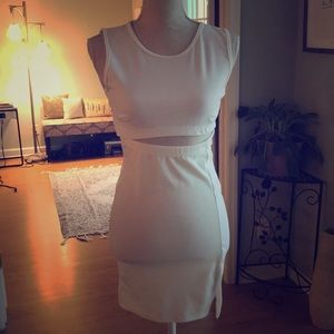 White dress with cutout under boob and slit